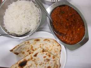Butter chicken, rice, and garlic naan in Mumbai, India.Butter chicken, rice, and garlic naan in Mumbai, India.