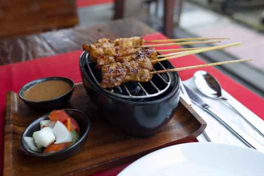 Chicken, pork, and beef satay in Ubud, Bali.