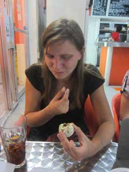 Eating balut - fertilized duck embryo - in Manila, Philippines.