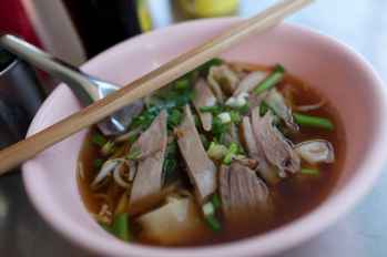 Duck and wonton soup in Chiang Mai, Thailand.