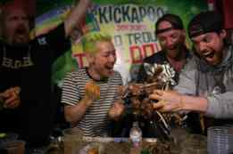 Victory! A team of competitive eaters ate a 40-pound goat to beat the Chicago Cubs billy goat curse.