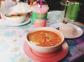 Massaman Curry, a thick curry made with coconut milk and cashews. The spicy broth is perfectly matched with a sweet strawberry shake.