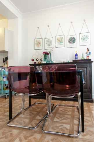 Pink lucite chairs from IKEA.