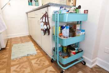 Teal kitchen cart.