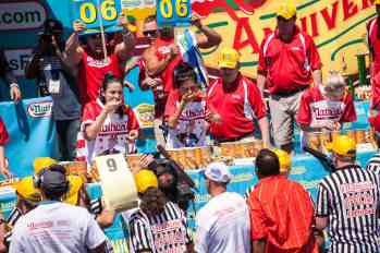 Juliet Lee eats at the 2016 Nathan's Famous hot dog eating contest at Coney Island.
