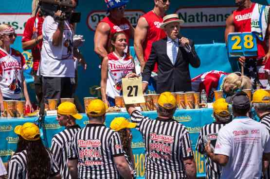 Michelle Lesco eats at the 2016 Nathan's Famous hot dog eating contest at Coney Island.