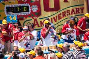 Eric 'Badlands' Booker eats at the 2016 Nathan's Famous hot dog eating contest at Coney Island.