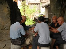 old men playing cards in a cave