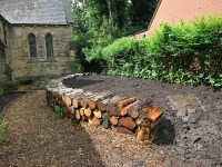 Raised Bed with Log Wall nearly ready for planting with ...