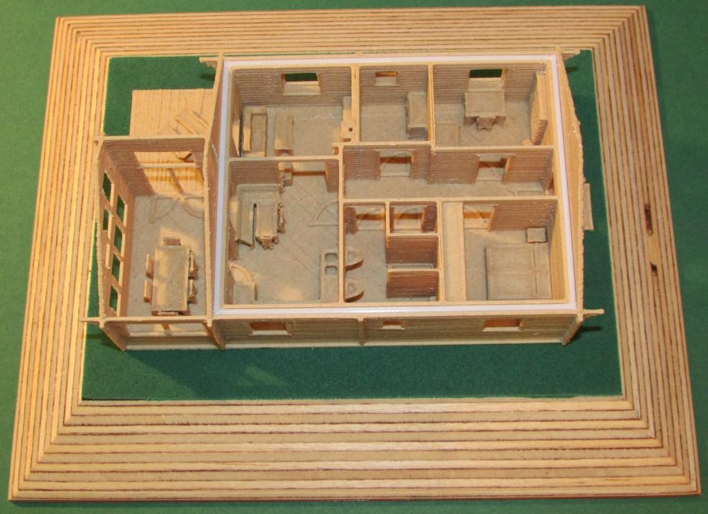 3D-gedrucktes, möbliertes 1:100 Modell eines Blockhausbungalows der Firma Finnhaus