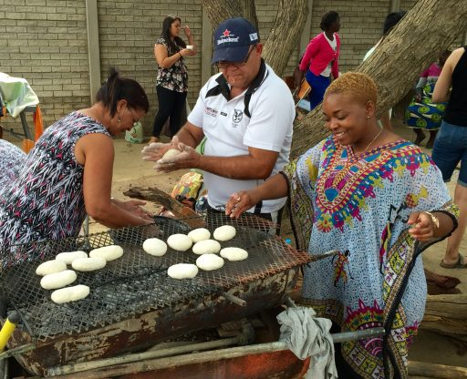 Jamille helps the Afrikaans language group (and our host families) prepare braai brood (roasted bread) in the grill.