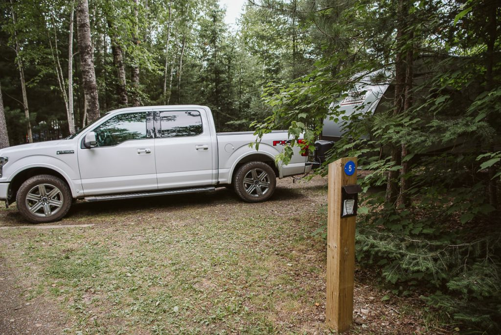 Camping with truck and RV in site 5e at the Chippewa loop in the Dawson Trail Campground in Quetico Provincial Park.