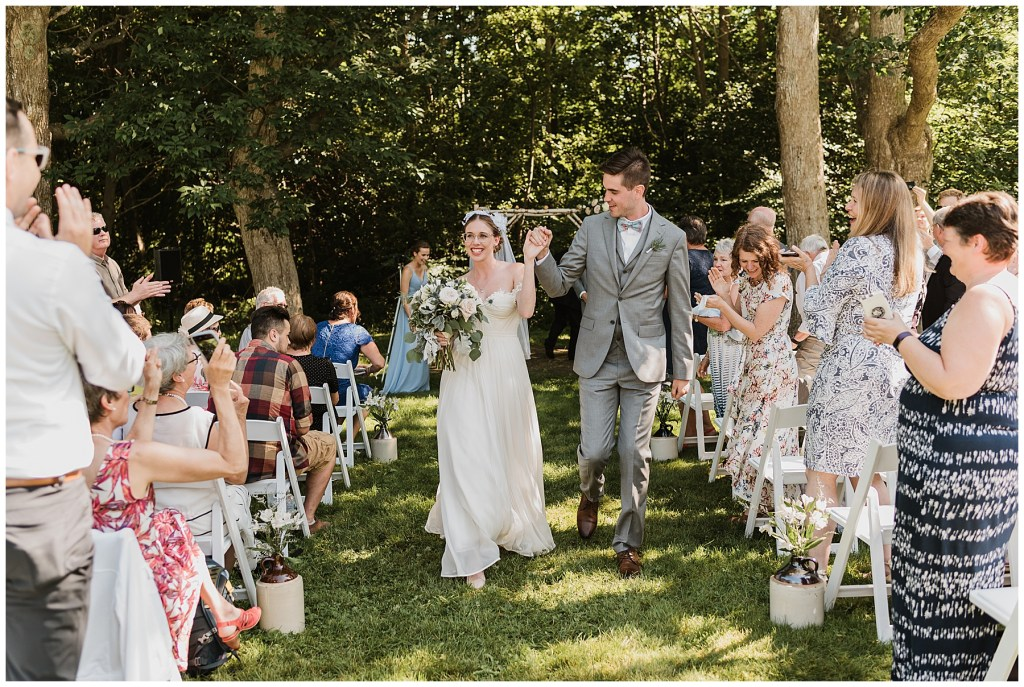 bride and groom walk down the Aisle at Crystal Cliffs Wedding Venue