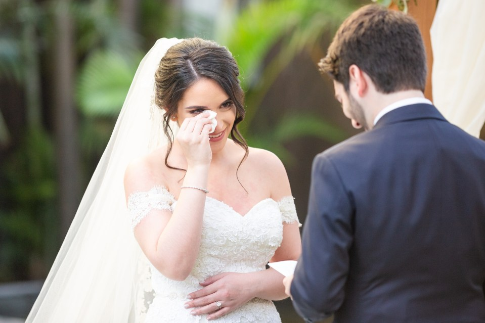 Bride wiping a tear during her outdoor wedding ceremony. Choosing the perfect wedding ceremony time for your wedding day | Chris Sosa Photography
