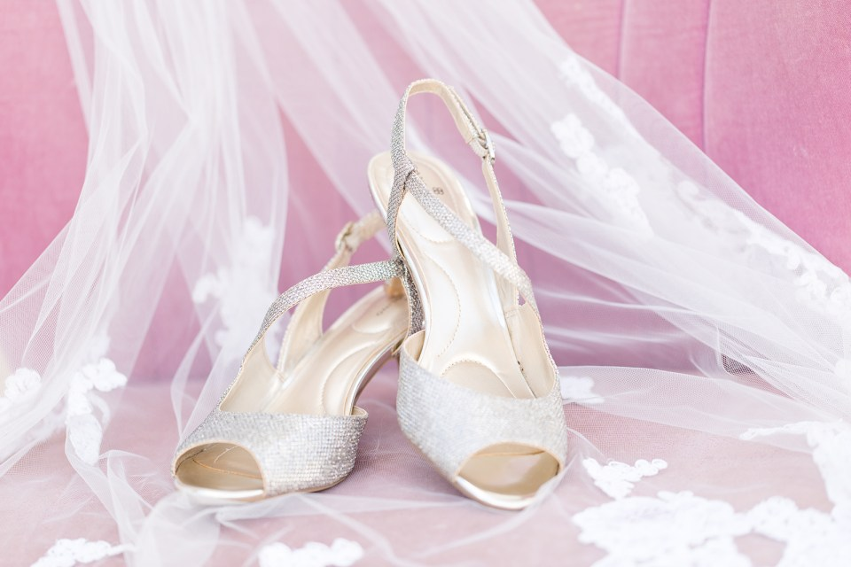 Bride shoes on purple chair and vail