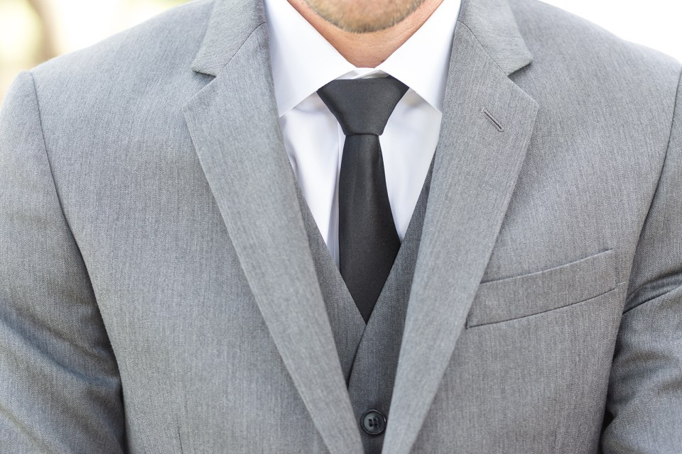 grooms grey suit and black tie