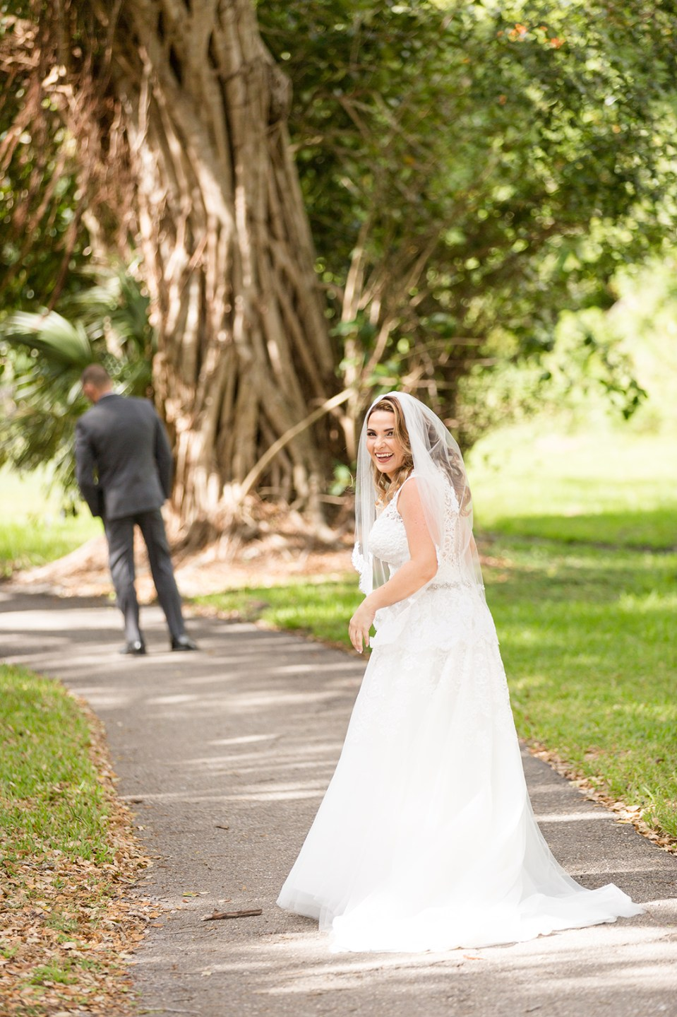 bride turned back smiling before the first look