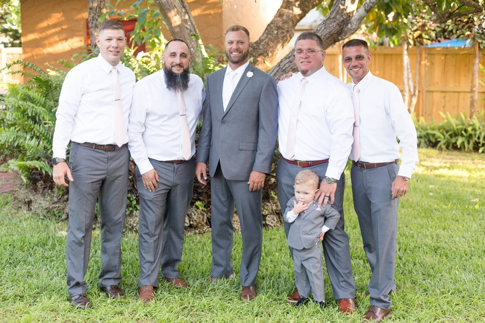 groom and groomsmen in grey suits and white shirts