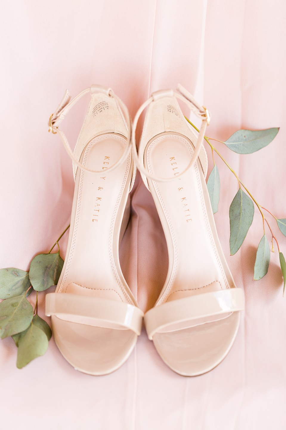 brides beige shoes with greenery