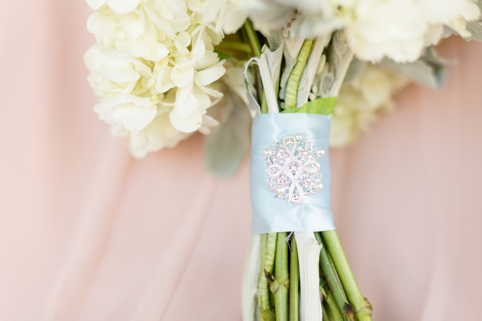 bridal bouquet white flowers and blue ribbon