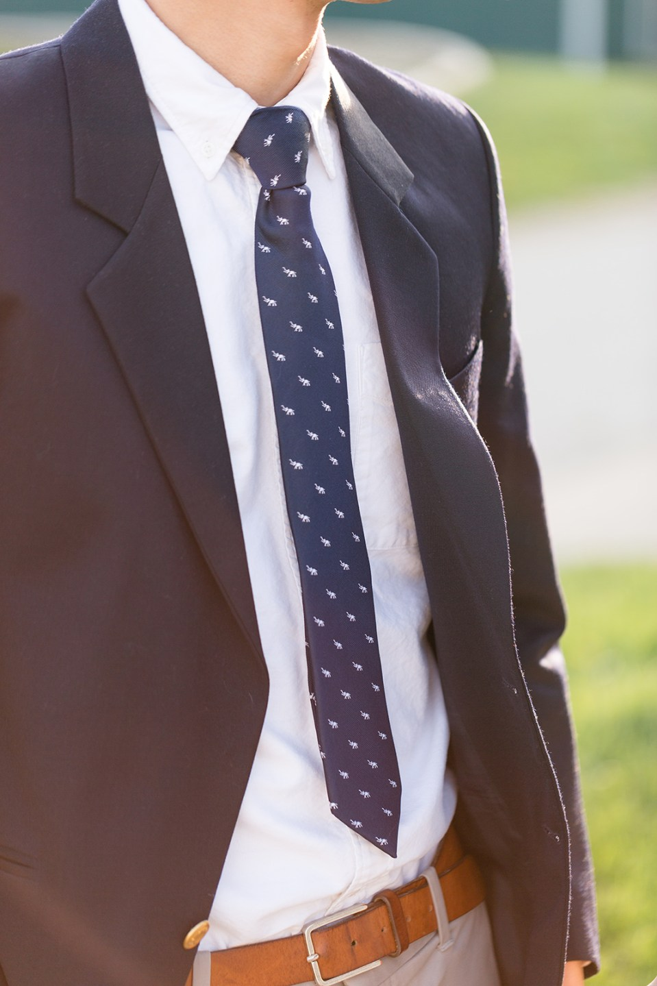 closeup of man's navy blue tie with white whales on it