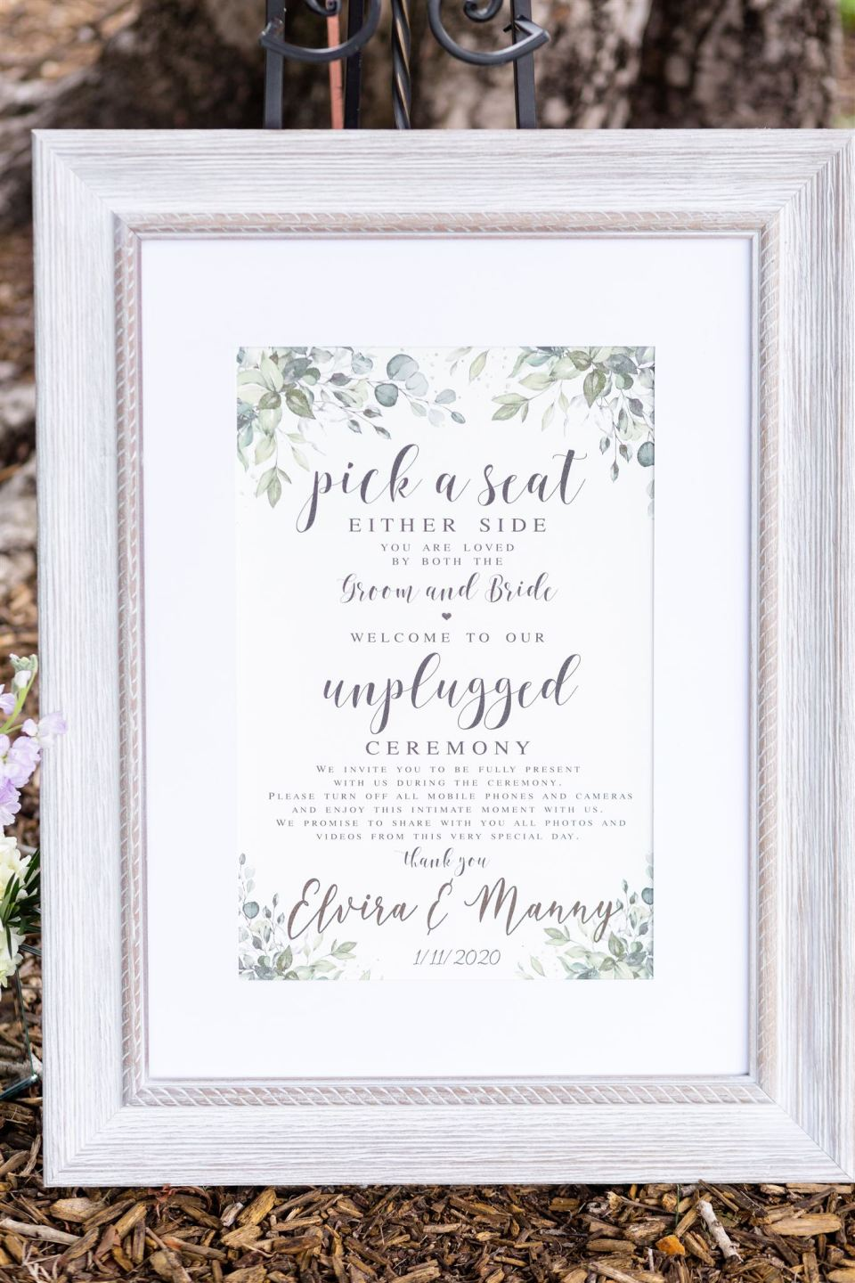 framed sign that says Welcome to our unplugged wedding ceremony