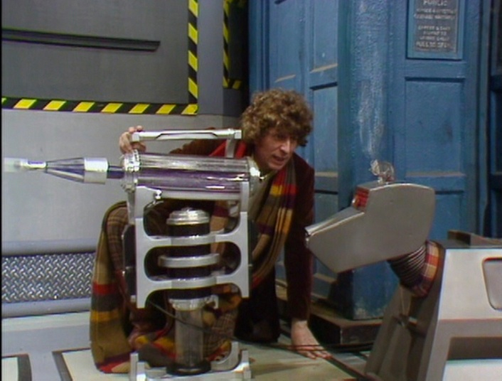 The Fourth Doctor giving K-9 instructions