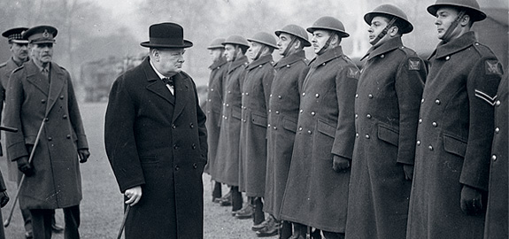 Winston Churchill inspects British troops in 1941.