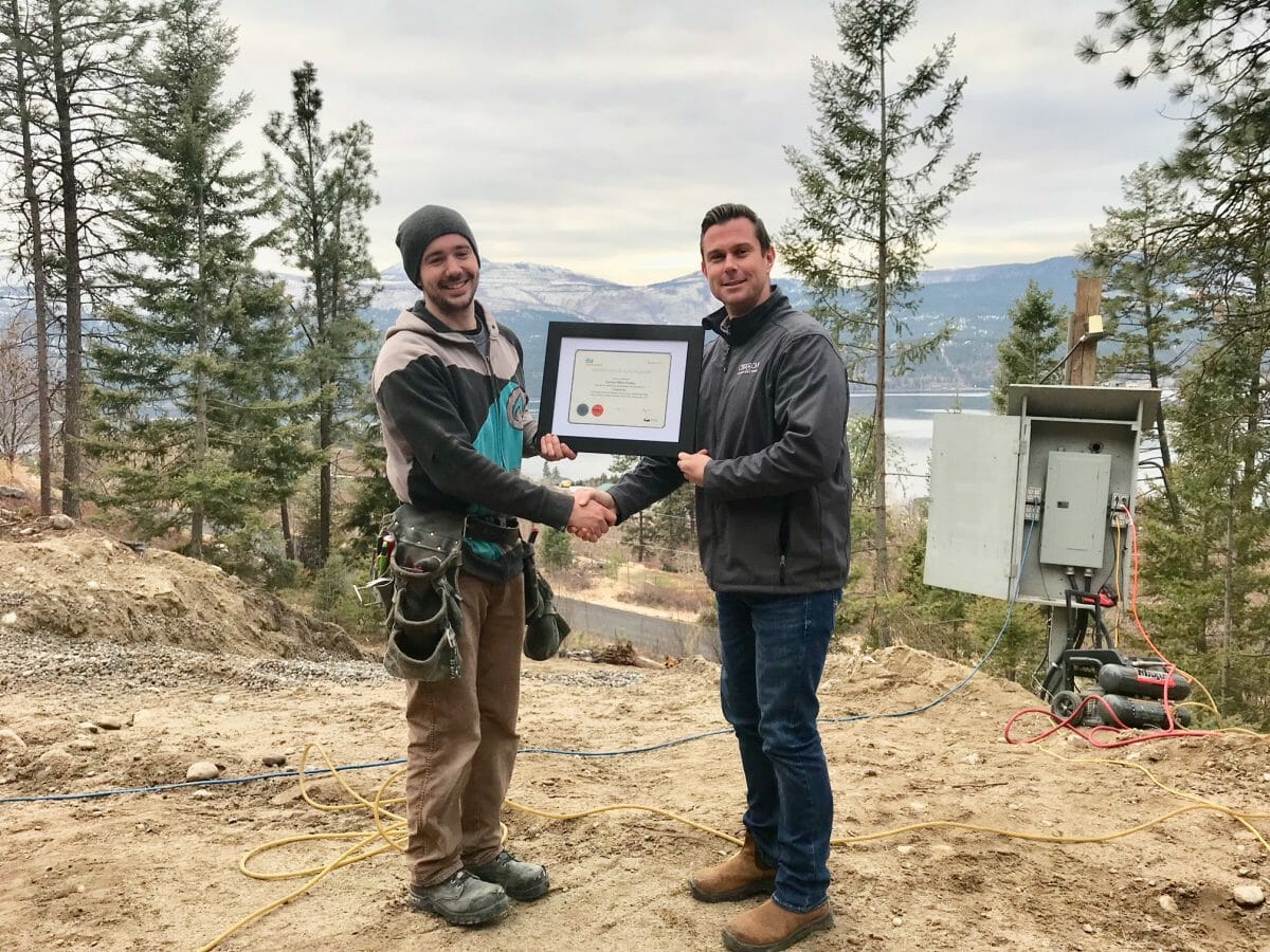 Chriscan owner Jim Kitchen presents Damian Findley with his Journeyman certificate for carpentry