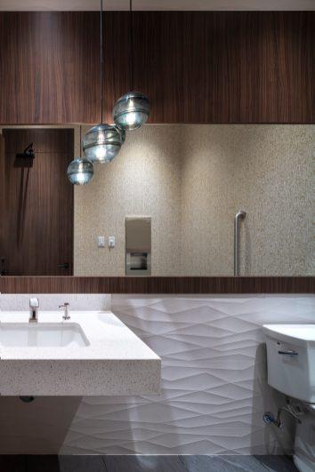Modern bathroom with pedestal sinks at Quail Ridge Dental Office.