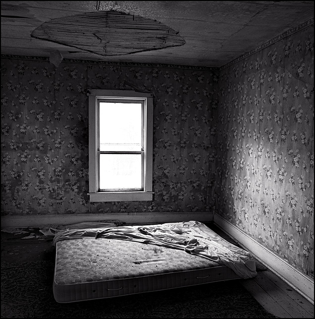 An old mattress on the floor in the bedroom of an