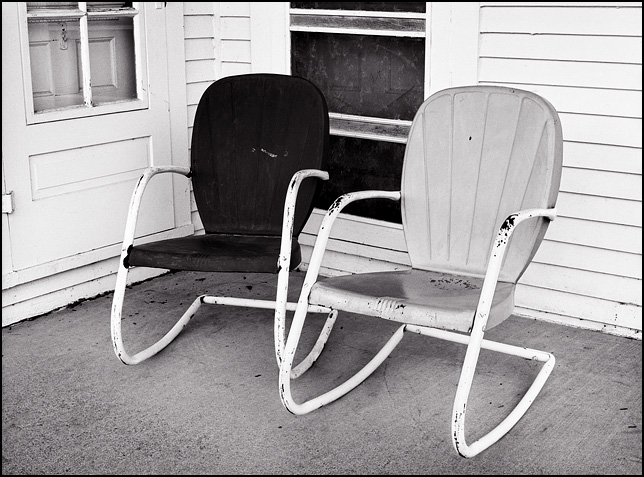 Motel chairs on the porch of a farmhouse  Photograph by