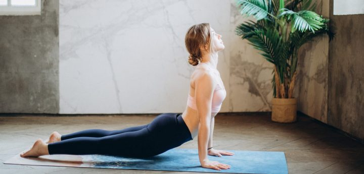 Woman in a yoga pose, cobra