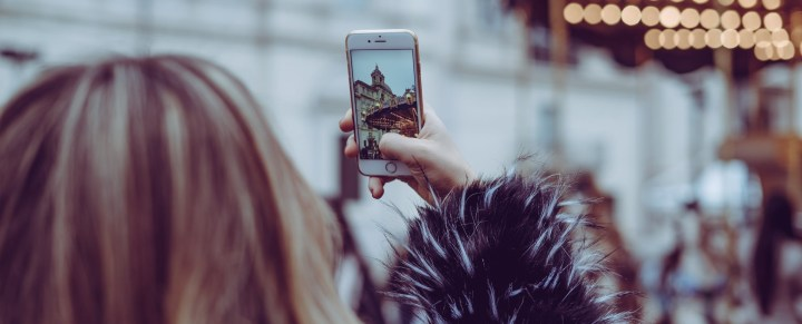 Person looking at picture on phone