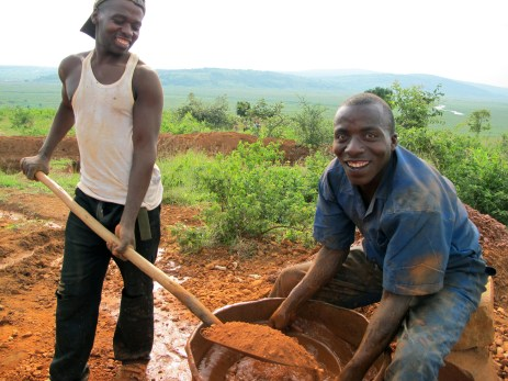 Men who normally farm this field now pan for precious metal