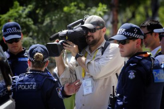 Scott Kyle filming the arrest of a protester. ABC News, 2014