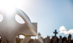 Sunlight behind a gravestone