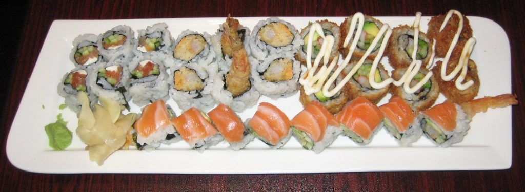 Wasabi Asian Cuisine - Clockwise (from top left) - Philly roll, Dynamite roll, Deep fried California roll, Salmon dragon