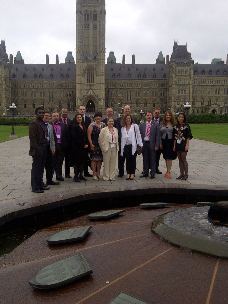 Photo of the The members of the New Brunswick Study Group for the 2012 Governor General's Canadian Leadership Conference in front of Parliament