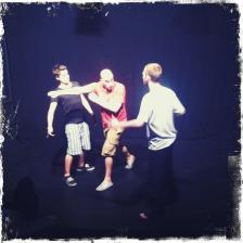 Matt Gardner showing Daniel Chrisostomou how to stage-punch James Lewis.