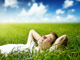 man relaxing in the grass