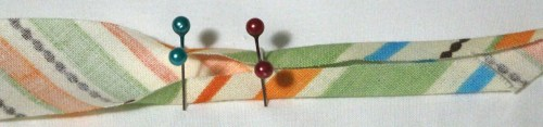 4 pins over the top of the bias binding tape ready for pressing the next section - Bias Binding Tutorial