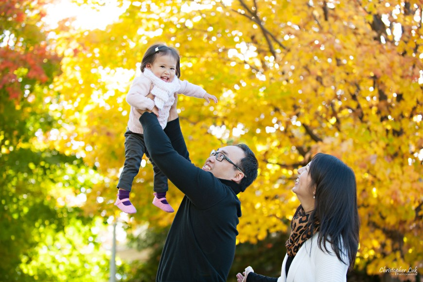 Christopher Luk 2014 - The C Family Baby Toddler Girl Lifestyle Session - Toronto Wedding Event Photographer - Mother Father Mom Dad Daughter Toddler Baby Girl Walking Smiling Orange Colour Autumn Fall Leaves Photojournalistic Candid Natural Relaxed Lift Jump Bounce Fly Laugh Smile
