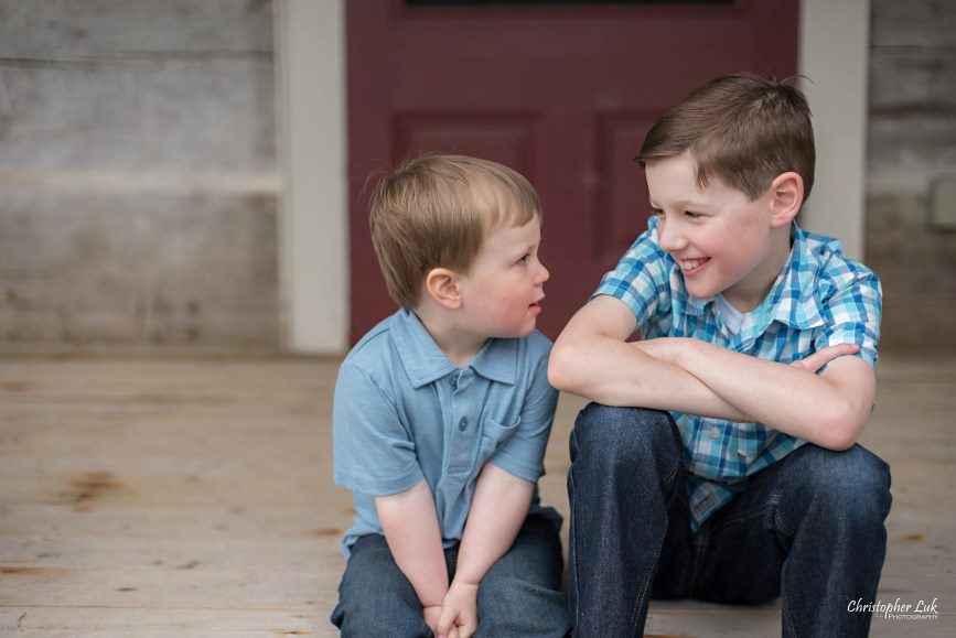Photojournalistic Candid Natural Child Son Toddler Boy Brothers Adorable Cute Historic Log House Farmhouse Red Door Look Together
