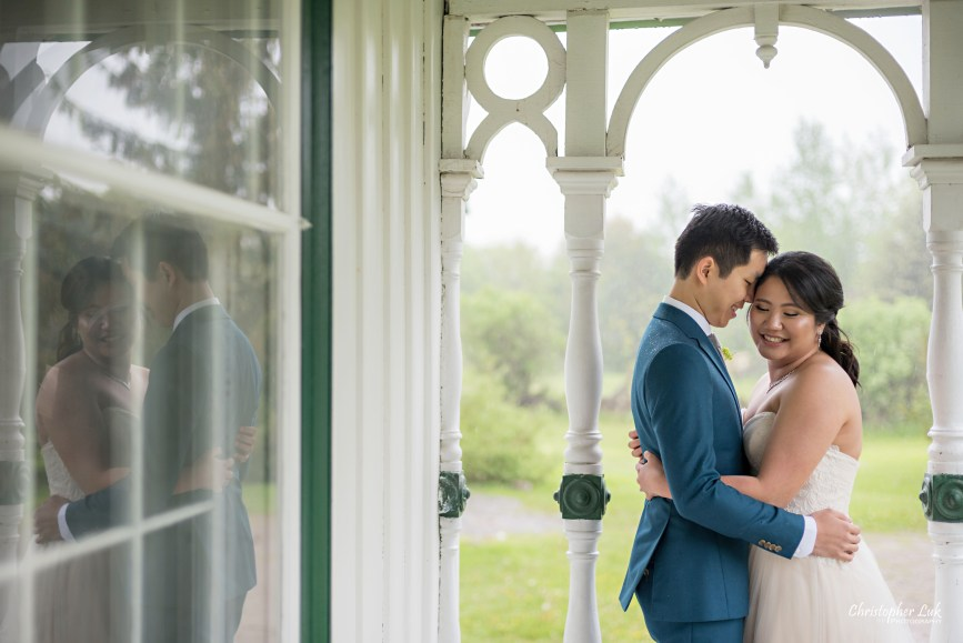 Christopher Luk: Toronto Wedding Photographer: Markham Museum Scarborough Chinese Baptist Church SCBC Columbus Event Centre Sala Caboto Natural Candid Photojournalistic Bride Groom Portrait Hug Holding Each Other Close Leading Lines Historic White Wood Home Burkholder House Covered Porch Verandah Close Up Reflection Smile