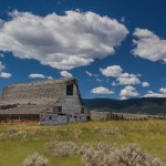 An old barn stands watch over the foothills of the Montana Rocky Mountains