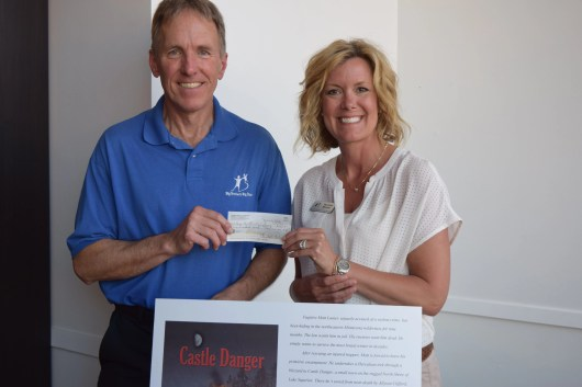Presenting the first donation of $100 to Michelle Redman, Executive Director of Big Brothers Big of Sisters of Southern MN.