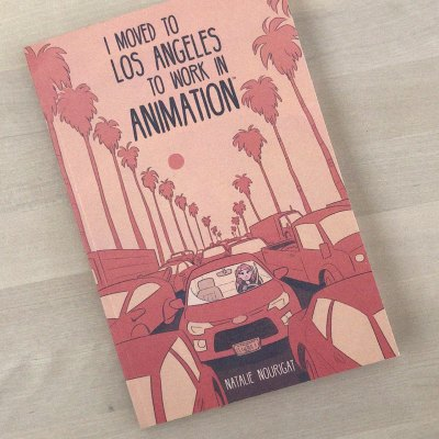 """Cover image for Disney Storyboard Artist Natalie Nourigat's graphic novel: """"I Moved to Los Angeles To Work In Animation."""" A cartoony illustration in pink monochrome of a young woman, stuck in a traffic jam, alone in her car. Palm trees and vehicles extend into the distance."""