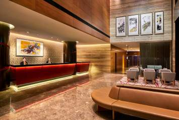 Interior Photography of the Ramada at Zhongshan Park Singapore hotel lobby with staff