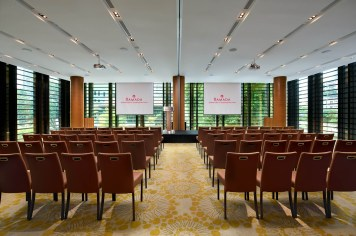 Interior Photography of the Ramada at Zhongshan Park Singapore Meeting room in a theatre setup with the hotel logo on screens